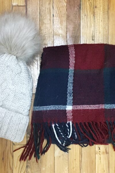 off-white hat with pompom and plain burgundy scarf